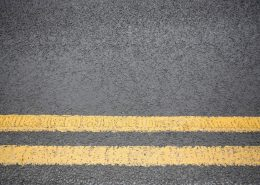 Line Marking - two yellow lines painted on asphalt road